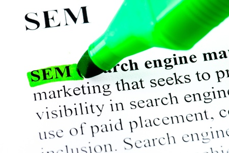 sem: SEM search engine marketing definition highlighted by green marker Stock Photo