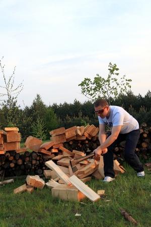 Man cutting wood outdoors photo