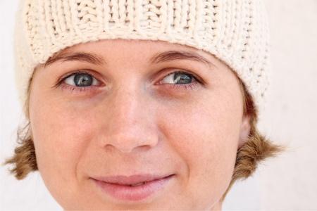 Young woman wearing winter cap. Autumnal portrait. photo