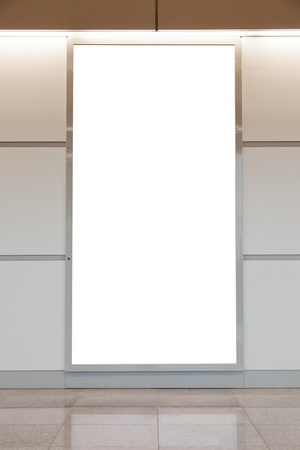 blank poster: Vertical blank billboard on a bright wall