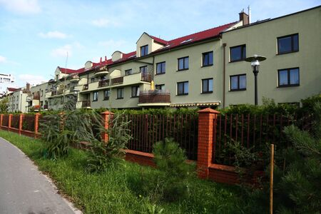 Row of similar houses in suburbia of Warsaw, Poland Stock Photo - 11596309