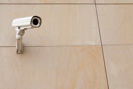 Security cameraslocated on marble wall of building photo