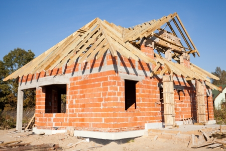 Unfinished house of brick, still under construction Stock Photo - 12605100