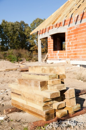 Wooden planks in front of unfinished house of brick Stock Photo - 12605052