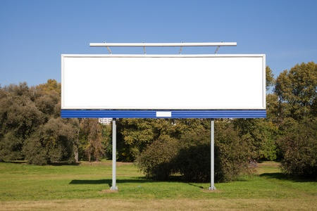 outdoor advertising: Blank billboard on green grass for your advertisment