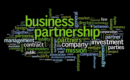 Business partnership concept in tag cloud on black photo