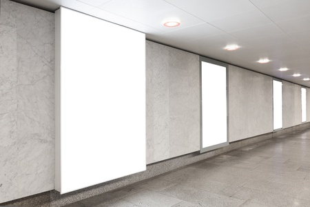 Blank billboards located in underground hall useful for your advertising photo