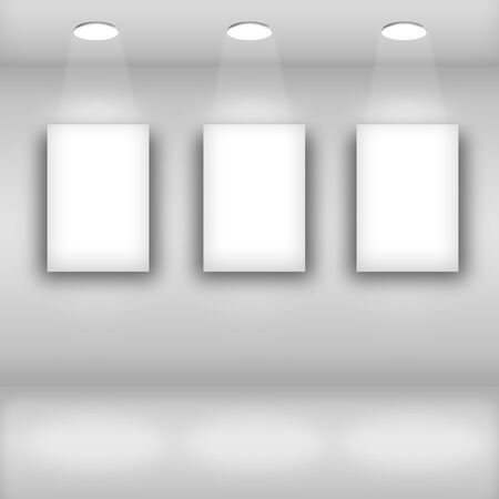 Spotlights in gallery interior with blank frames on wall photo