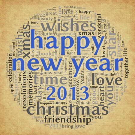 Happy New Year 2013 greeting card in tag cloud on old paper photo