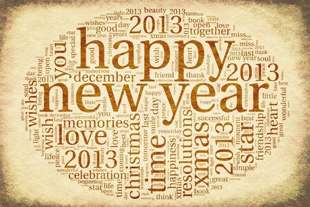 Happy New Year 2013 greeting card in tag cloud on old paper Stock Photo - 16539299