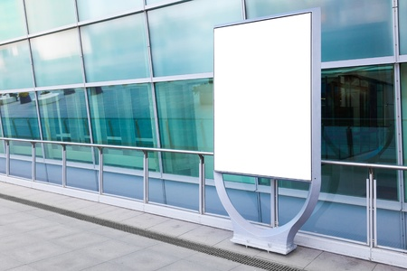 Blank billboard in front of modern building in a city. Put yout advertising, Stock Photo - 16663195