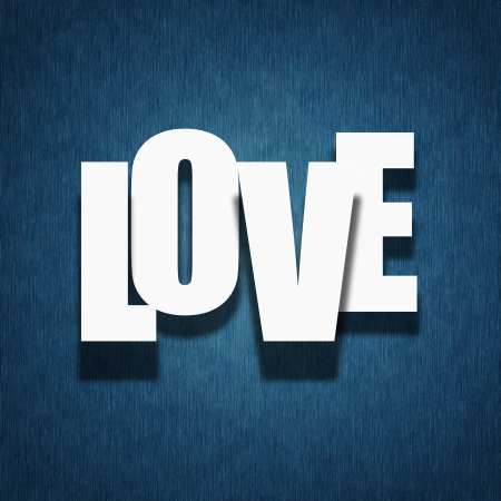 Love concept - paper letters on dark blue vintage fabric background photo