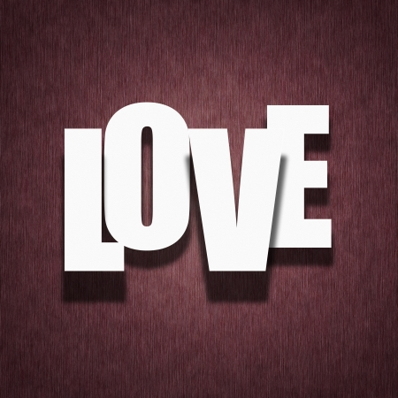 Love concept - paper letters on dark red vintage fabric background photo