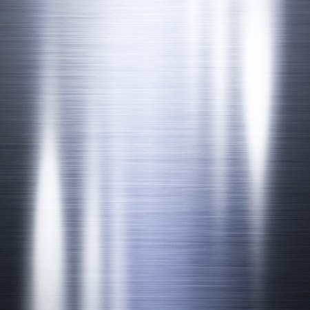 Metal background or texture of brushed steel with highlights useful for your background Stock Photo