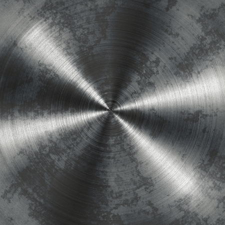 Old grunge brushed metal plate with reflections in circular shape
