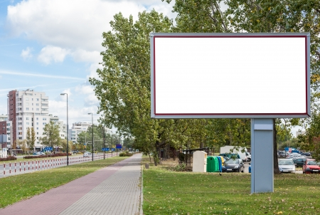 Blank billboard on road in city Banco de Imagens