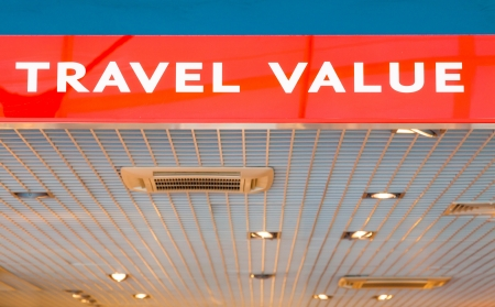 reduced value: Travel value and duty free shop on airport - red advertising