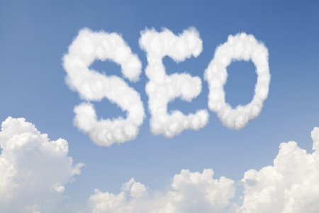 SEO search engine optimization concept text word in clouds on blue sky photo