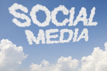 thumbup: Social media concept symbol in clouds on blue sky Stock Photo