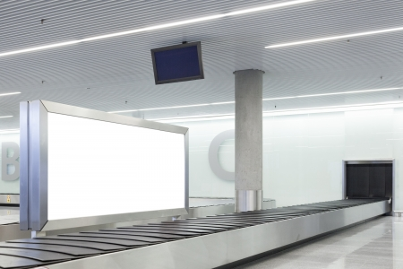 Blank billboard or poster located in airport underground hall photo