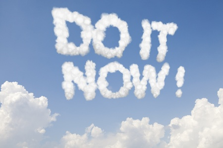 Do it now concept text words in clouds on blue sky photo