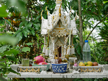 Selective focus of white-golden spirit house in Thailand