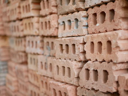 Selective focus of clay bricks used in house construction Stok Fotoğraf - 107425822