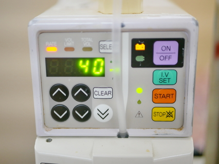 Close up of an infusion pump infusing fluids and nutrients into a circulatory system of a patient