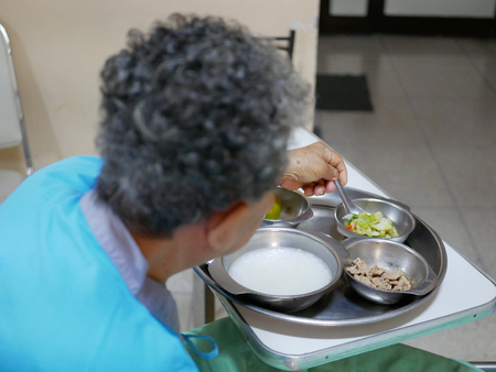 Patient food provided by a hospital for elderly sick woman