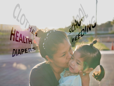 Asian mother hugging and kissing her daughter, while worrying about her daughters clothes, health, diapers, feeding, and school Stock fotó