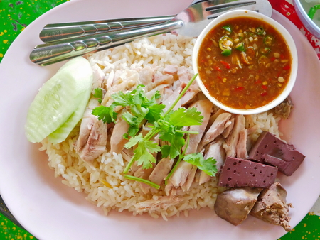 Chopped boiled chicken on top of garlic steamed white rice (Kao Mon Kai) - delicious and healthy street food in Thailand