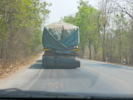 Driving behind big truck in Thailand - driver's point of view / perspective Stock Photo