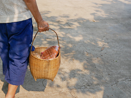 Stuff in a basket being carried for Rod Nam Dam Hua ceremony, paying respect to the elders, during Songkran festival in Thailand