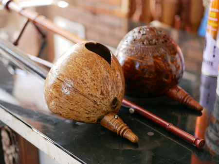 Selective focus of two salors, two or three-string spike fiddle used in the Lanna region or in the North of Thailand, on a table Stock Photo
