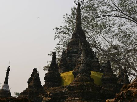 Old grungy rotten pagodas ( chedi ) - Buddhist religious architecture