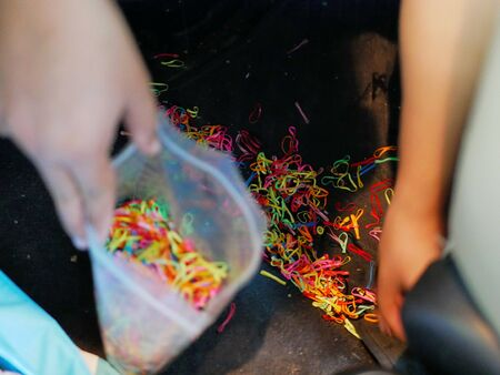 Many elastic hairbands dropped in a car - dealing with the mess, traveling with kids