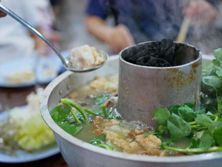 Cooking hot pot with hot charcoals in the middle, originally from Yunnan, China, adapted and cooked tastier in the North of Thailand. The menu is so called Suki Yunan