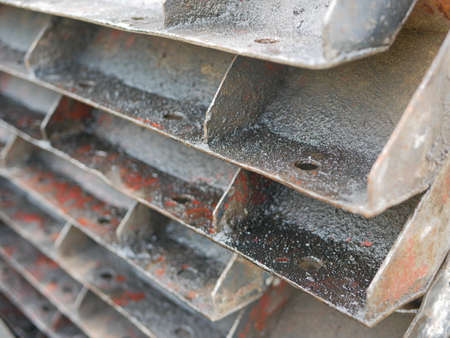 Metallic molds for building a concrete fence covered with oil to help prevent them from becoming rusty