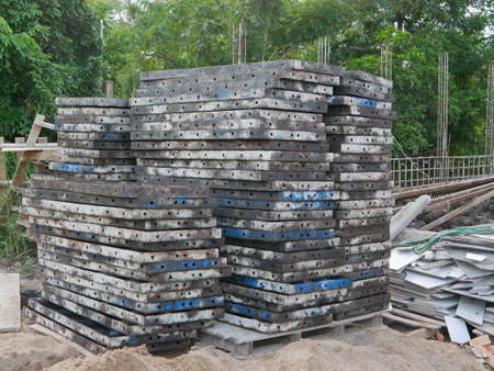 Piles of metallic molds for building a concrete fence at a construction site ready to be used 免版税图像