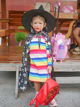 Little girl, 3 years old, is happy with her Halloween makeup and dresses done before attending her school event 免版税图像