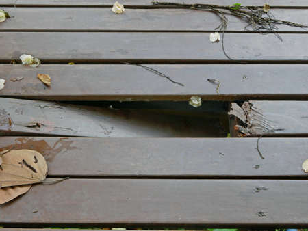 Damaged, rotten, area of outdoor wooden floor due to being exposed to rain and sunlight, could cause serious accident / injury Reklamní fotografie