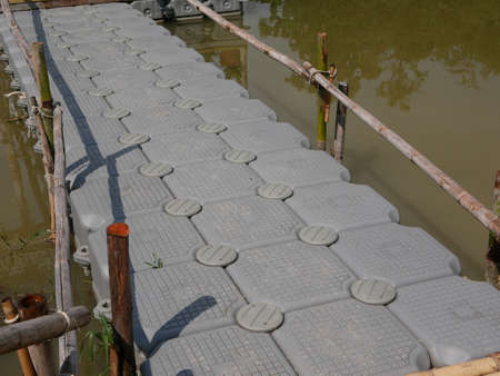 Plastic dock / pontoon cubes / boxes / walkway / path, floating on water surface