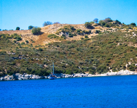 the scenery on the sea boat away shrouded hills