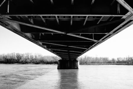 Steel bridge design above the river urbanistic view of achieving humanity black and white photo