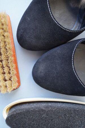 Proper care for black suede leather footwear brush Sponge Items Macro Photo
