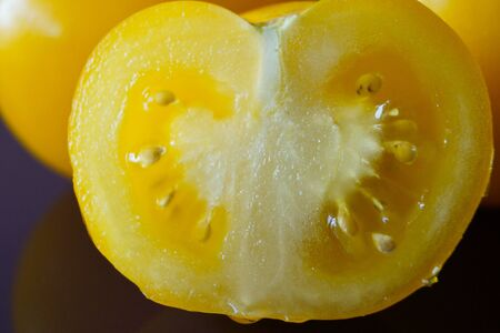 Vegetable berry Yellow tomato sectional with macro Photo organic product