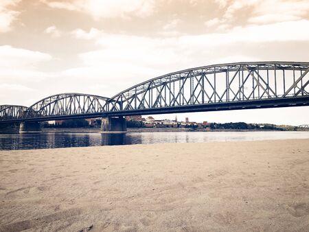 beautiful landscape of a European city metal bridge across the river near the beach Banque d'images