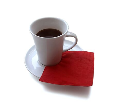 a cup of coffee on a red napkin on a white background. close-up.