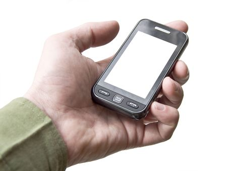 The hand holding a cell phone touchscreen. White background. White screen of the device. Isolation.