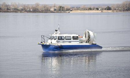hovercraft: Hovercraft rides on the water, creating splashes.
